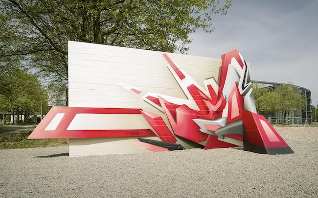 """Mirko Reisser (DAIM)   """"Die Mauersprengung""""   Sculpture   240 x 500 x 200 cm   2006   Exhibition: """"sculpture@CityNord""""   Hamburg / Germany"""